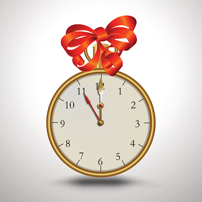 golden clock with red bow on top