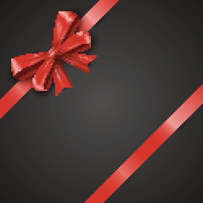 Gift realistic red bow and ribbons tilted on a black