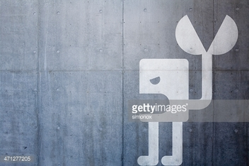 Angry robot on concrete background