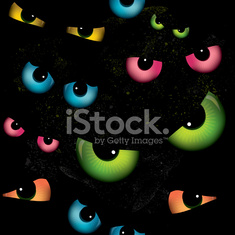 Spooky cat eyes seamless background