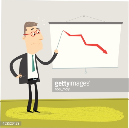 Worried businessman pointing at a graph