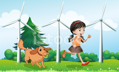 Girl playing with her dog near the windmills