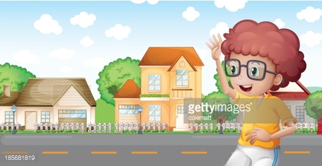 boy jogging in front of the neighborhood