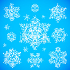 White snowflakes set on blue background