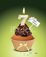 Birthday cupcake with candle number 7