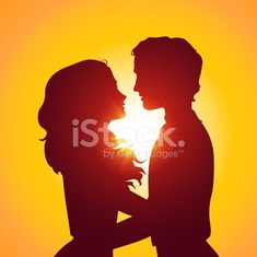 Sunset silhouettes of kissing couple