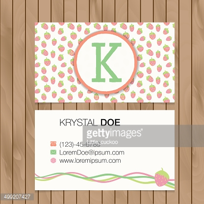 Business card with alphabet letter on a wood background