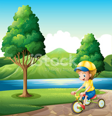Boy playing with his small bike