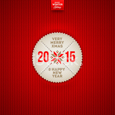 Christmas and New year greeting label on a knitted background