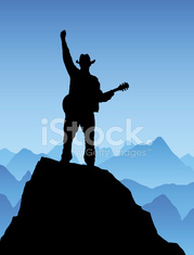 Triumphant country guitarist with blue sky