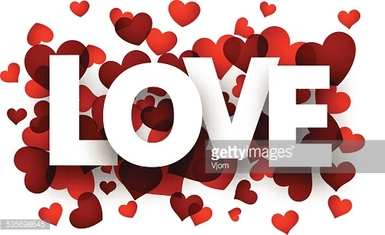 Paper love sign over red hearts.