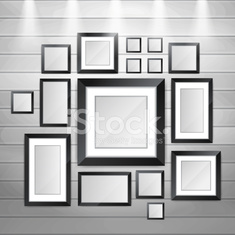 Pictures and photos frames on the wood wall.
