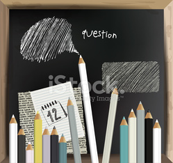 Black board with pastels.
