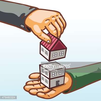 Real estate concept hands giving and receiving building