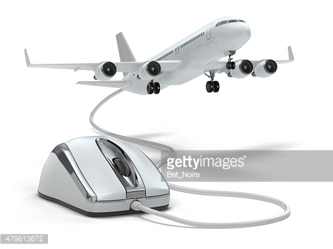 Online booking flight or travel concept. Computer mouse and airp