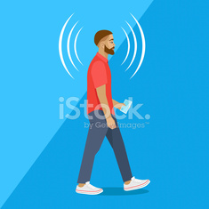 Modern man walks with a smartphone. Connection