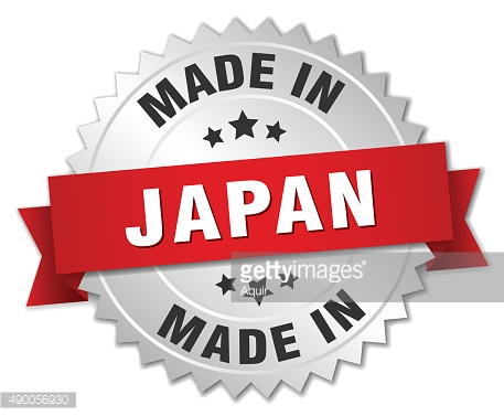 made in Japan silver badge with red ribbon