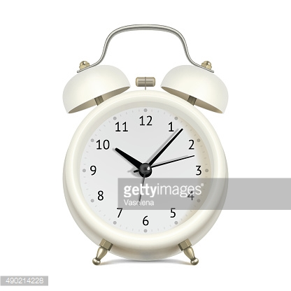 White alarm clock on white background