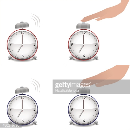 Hand and stopped alarm clock