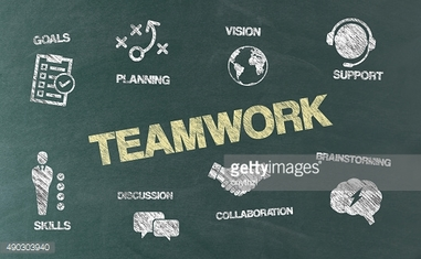 Teamwork Concept with Icons on Blackboard