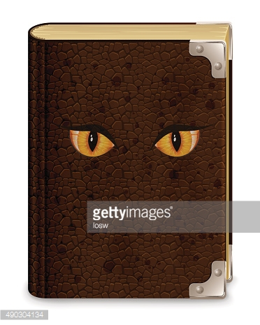 Old book with eyes