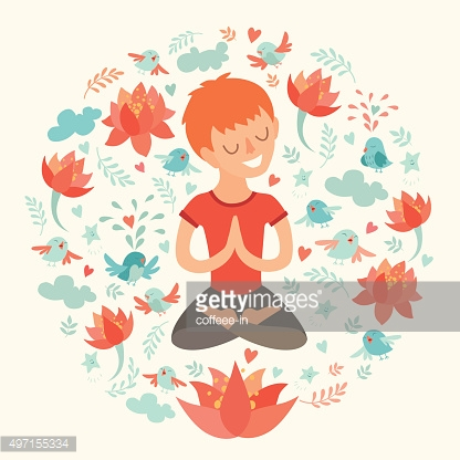 Little boy in the lotus position with lotus flower
