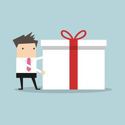 Businessman holding a big gift box for Christmas festival