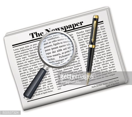 Newspaper with magnifying glass and pen