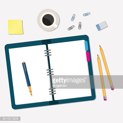 office workspace with open book and objects