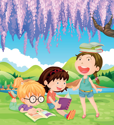 Girls reading books in the park at daytime
