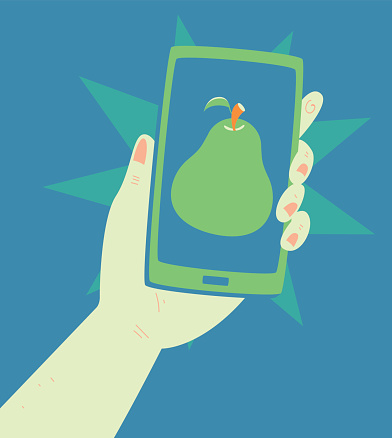 Hand Holding a Phone with a Pear Inside