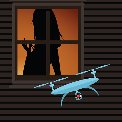 Drone spying on a woman through a window