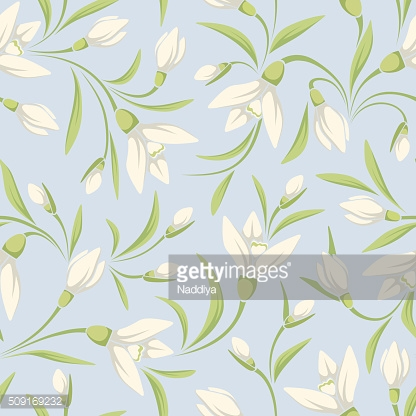 Seamless pattern with white snowdrop flowers on a blue background.