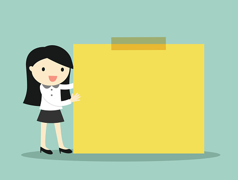Business woman holding yellow sticky note with green background.
