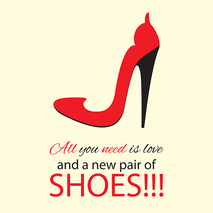 Womens high heel red shoes with text.