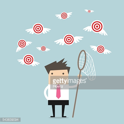 Businessman try to catch flying target