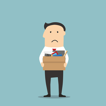 Fired businessman leaving office with box