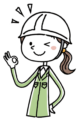 Woman OK sign of work clothes wearing a helmet