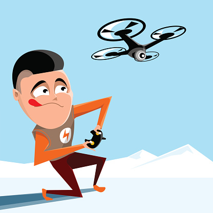 Boy controling quadrocopter. Drone hovering in the sky above mountains