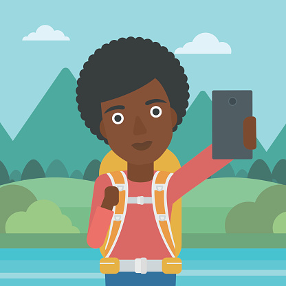 Woman with backpack making selfie.