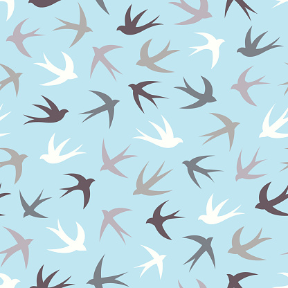 Seamless pattern with a flock of swallows.