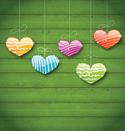 Colorful hearts hanging on green wooden texture for Valentine Da