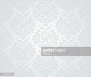 A beige colored seamless pattern with intricate designs