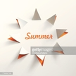 White paper cutout of a sun with summer text in orange