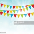 Cartoon party flags in blue sky background