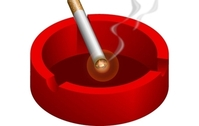 Ashtray with burning cigarette free
