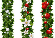Green Christmas garlands of holly and mistletoe